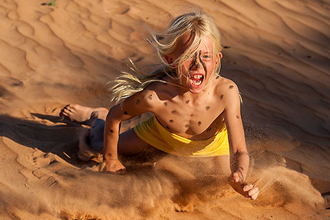 Enya mimicking cheetah on sand dune [©2009 paulgodard.com]