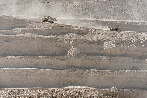 320 T trucks driving in & out of pit [©1970 paulgodard.com]