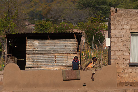 children playing near village house [©2009 paulgodard.com]